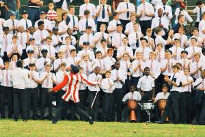 Michaelhouse being led in their war cry