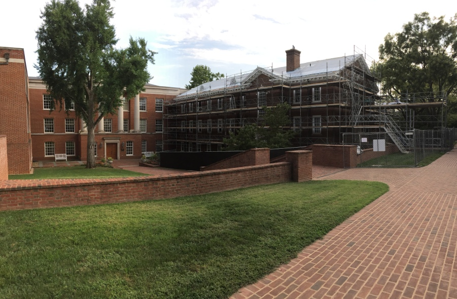 The old library is covered with scaffolding as it undergoes construction.